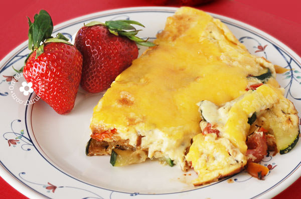 My all-time favorite breakfast -- Cheesy Frittata with Zucchini, Basil and Red Peppers! {Low Carb!} OneCreativeMommy.com